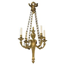 Pair of Louis XVI style gilded bronze four-light chandeliers
