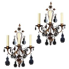 Pair of Napoleon III iron and crystal three-light sconces France, circa 1860