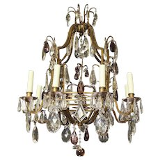 Bagues style gilt iron eight light chandelier w amethyst and clear crystal