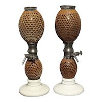 "Glass and porcelain seltzer dispensers with rattan cover signed ""Gazogene, Briet"" France, mid 19th century"