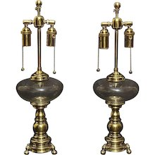 Dutch Baroque bronze two light lamps with glass fonts, 19th century