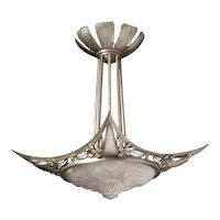 Art Deco nickeled iron and molded glass four-light chandelier