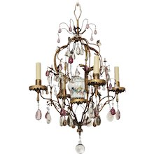 """""""BAGUES"""" Gilt Bronze and Tole four light chandelier with porcelain chinoiserie urn and clear and amethyst crystal sprays. France"""