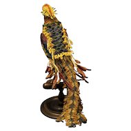 Multi-coloured glass beaded cockatiel on a wooden perch stand