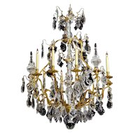 LOUIS XV Style gilded bronze and crystal eighteen light chandelier