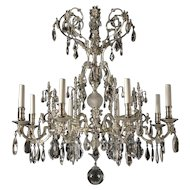 Silvered bronze and crystal eight light chandelier