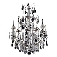 LOUIS XV Style silvered bronze and cut crystal nine light chandelier