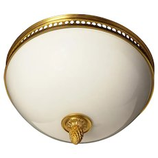 Gilded bronze and opaline glass flush mount with open grill banding.