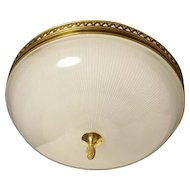 Gilded bronze and ribbed glass flush mount with heart banding, three lights