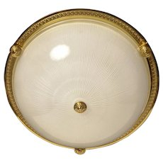 Gilded bronze and ribbed glass flush mount with button, three lights