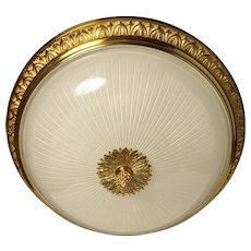 Gilded bronze and ribbed glass flushmount with leafy gallery, four lights