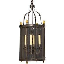 LOUIS XVI Style gunmetal and gilded bronze four light lantern.