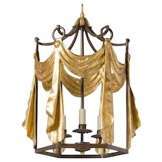 """TENDE"" Black and gilded iron three light lantern."