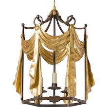 """TENDE"" Black and gilded iron three light lantern."