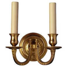 Gilded bronze two light sconce with square arm and beaded back