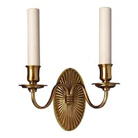 Gilded bronze two light sconce with fluted oval back