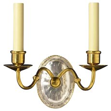 Gilded bronze and cut crystal back two light sconce