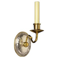 Gilded bronze and cut crystal back one light sconce
