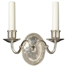 Nickeled bronze and cut crystal back two light sconce