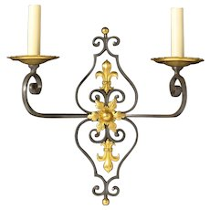 Dark and gilt bronze two light sconce