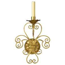 Gilded bronze one light sconce with scrolls