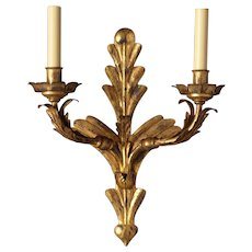 Distressed gilded iron leafy back two light sconce