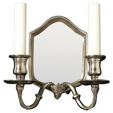 Silvered bronze two light antiqued mirror back sconce