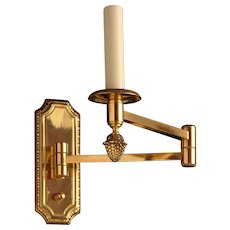 Gilded bronze one light swing arm sconce
