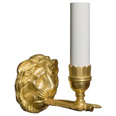 One light gilt bronze lion sconce with quivers
