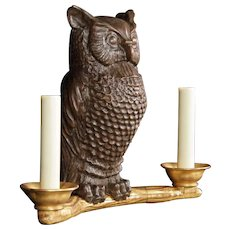 """""""ASSISE CHOUETTE"""" carved giltwood and painted two light sconce in a """"perched owl"""" motif."""