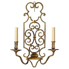 Antiqued brass strap work back two light sconce