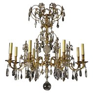 Gilded bronze and crystal eight light chandelier