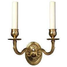 Gilded bronze two light oval back sconce