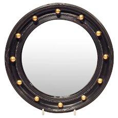 Round black mirror with gold balls