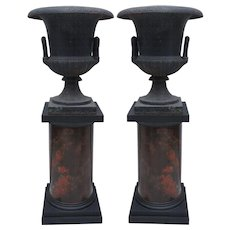 Pair of 19th Century Cast Iron Urns on Marbleized Pedestals