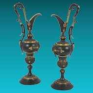 Pair Aesthetic Movement Patinated and Gilt Bronze Ewers