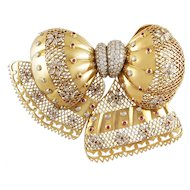 VAN CLEEF & ARPELS Diamond and Ruby Bow Brooch