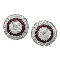 platinum ruby diamond with center round diamond earring