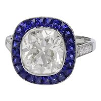 Platinum Sapphire Center Diamond Ring