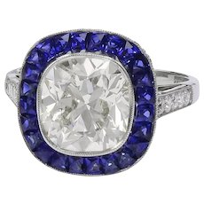 Platinum Sapphire Center Diamond Ring