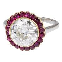 Platinum ruby center diamond ring