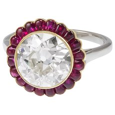 Platinum ruby center diamond ring