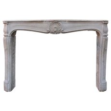 19th Century French Limestone Louis XV Style Fireplace