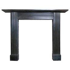 An antique Georgian Irish Black Marble Fireplace Mantel