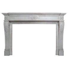 An Antique French Louis XVI Style Carved Marble Fireplace