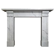 An Antique Late  Regency Marble Fireplace