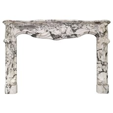 A large Rococo French Louis XV Breche Marble Fireplace