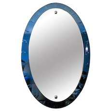 An Italian Blue Glass Framed Mirror