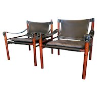 A pair of Arne Norell  leather Safari Chairs