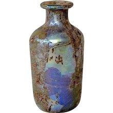 A Roman Iridescent Glass Flask 1st-3rd Century AD